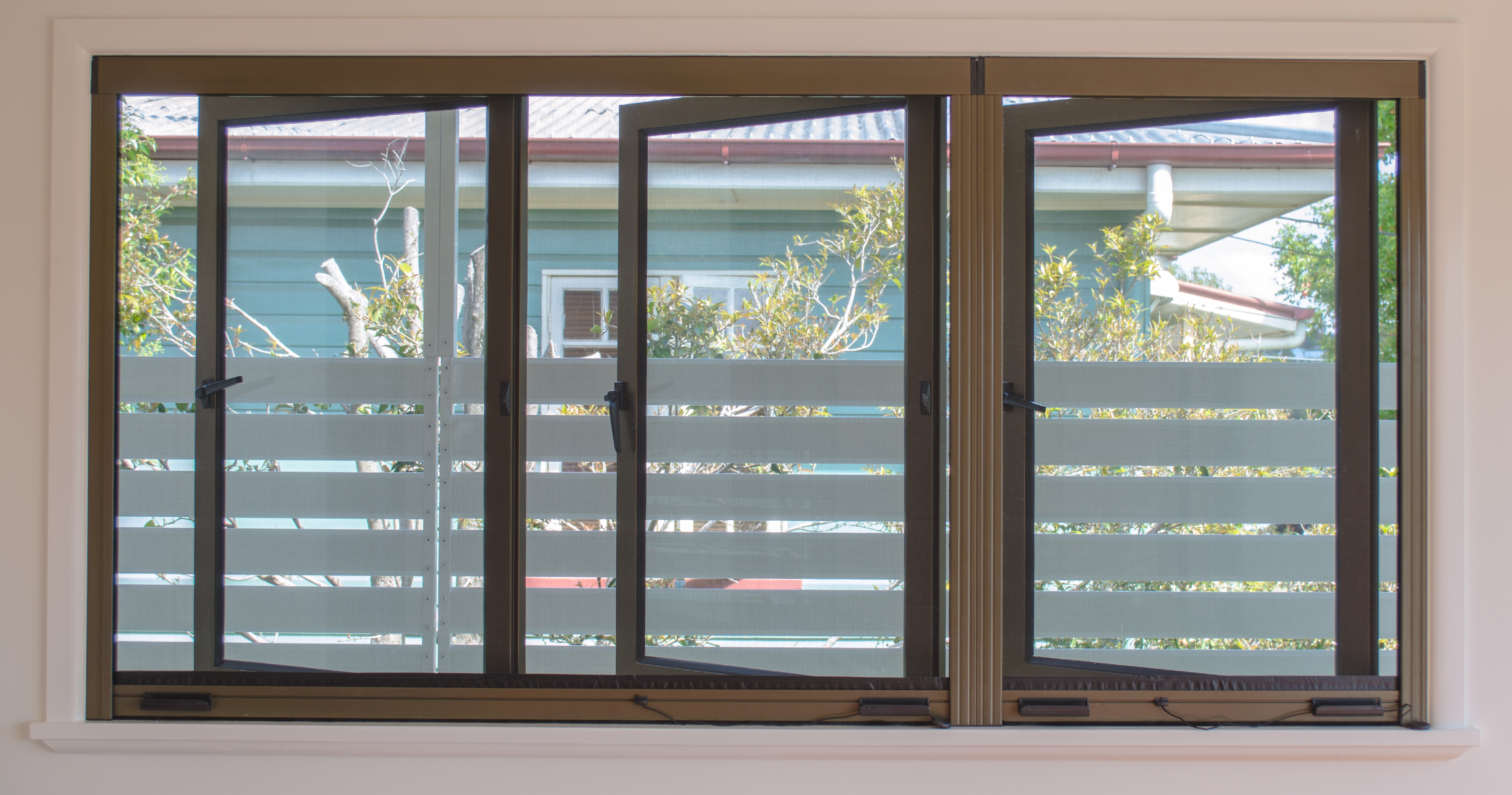 Retractable insect screens retractable fly screens for Retractable window fly screens